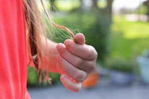 What causes female hair loss?